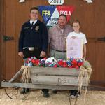 Reserve Champion Fryer Rabbits - Kevin Harrison; Buyer - Lindsey Construction