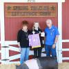 Grand Champion Swine - Kierstin Taylor CWFFA; Buyer - Larry's Bag of Smoke